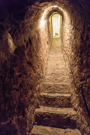 Romania. Bran. Castle Bran interior secret passageway. by Emily Wilson