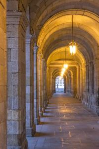 Spain, Santiago. Archways and Door Near the Main Square of Cathedral Santiago De Compostela by Emily Wilson