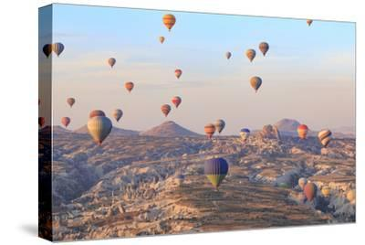 Turkey, Anatolia, Cappadocia, Goreme. Hot air balloons above Red Valley.