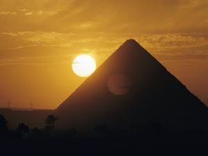 Sun over the Pyramids at Giza by Emory Kristof
