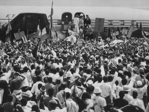 Emperor Haile Selassie Leaving Airplane and Waving to Welcoming Crowd