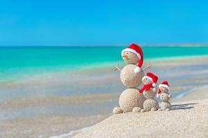Snowmans Family at Sea Beach in Santa Hat. New Years and Christmas by EMprize