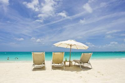 Empty Beach Chairs in the Sand on a Tropical Beach in the Caribbean-Mike Theiss-Photographic Print