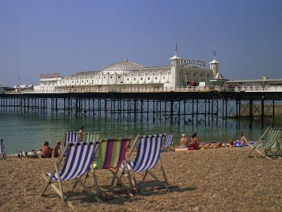 Empty Deck Chairs on the Beach and the Brighton Pier, Brighton, Sussex, England, United Kingdom-Miller John-Photographic Print