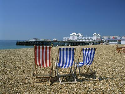 Empty Deck Chairs on the Beach and the Southsea Pier, Southsea, Hampshire, England, United Kingdom-Nigel Francis-Photographic Print