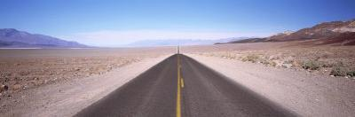 Empty Highway in the Valley, Death Valley, California, USA