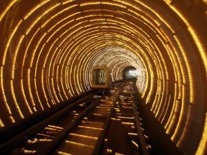 Empty Tourist Subway Car Runs Through Illuminated Tunnel in Shanghai, China