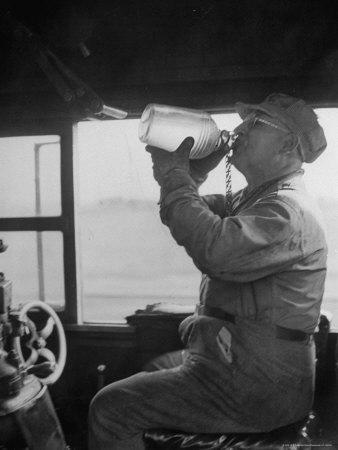 https://imgc.artprintimages.com/img/print/engineer-in-the-20th-century-limited-drinking-water-from-glass-jug-he-kept-underneath-his-stool_u-l-p44ilk0.jpg?p=0