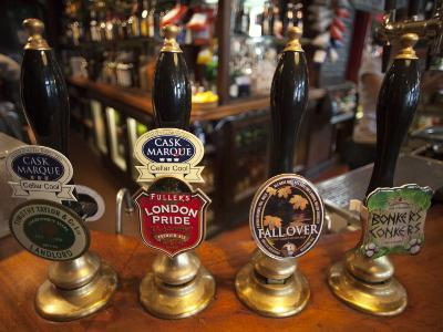 England, London, Beer Pump Handles at the Bar Inside Tradional Pub-Steve Vidler-Photographic Print