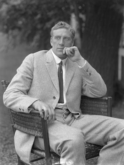 English Boxer William Thomas Wells (Bombardier Billy Wells), Posed Seated in a Tweed Suit, C.1911-William Davis Hassler-Photographic Print