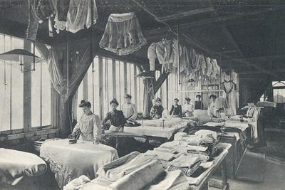 Interior View of a Laundry with a Line of Women Ironing
