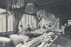 Interior View of a Laundry with a Line of Women Ironing by English Photographer