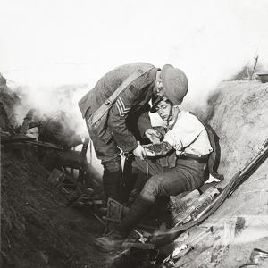 Receiving First Aid from His Sergeant in a Sap During the Height of Battle at Peronne, 1918 by English Photographer