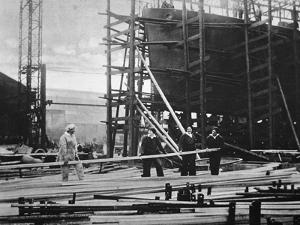 Women at Work in a Naval Ship-Building Yard, 1916 by English Photographer