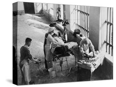 A Field Surgery Unit Operating in an Italian Prison under Fire During World War Two, from a…