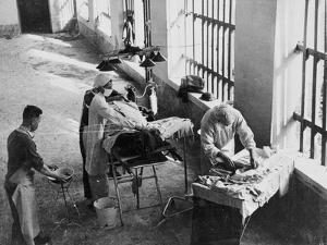 A Field Surgery Unit Operating in an Italian Prison under Fire During World War Two, from a? by English School
