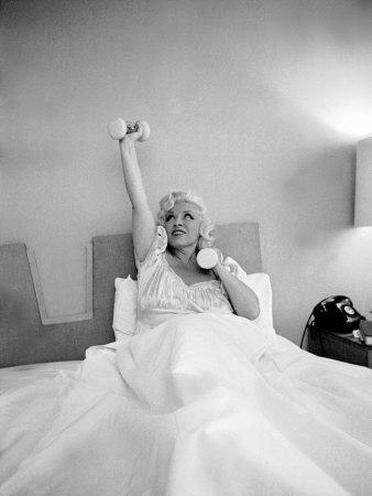Entertainer Mae West Lifitng Barbells in Bed-Loomis Dean-Photographic Print