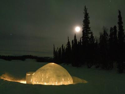 Igloo with Lights at Night by Moonlight, Northwest Territories, Canada March 2007 by Eric Baccega