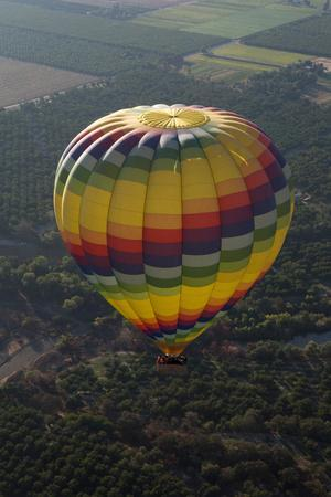 A Hot Air Balloon Flies over Agriculture and Vineyards in California, East of Napa Valley