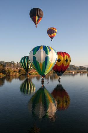 Hot Air Balloons from the Prosser Balloon Rally Float on and Above the Yakima River