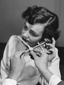 1949: Caliper Measuring 1-4,000 Faces to Determine Dimensions of Handset for New Bell Telephone by Eric Schaal