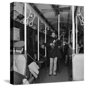 Activist Folk Musician Woody Guthrie Playing for a Subway Car of New Yorkers by Eric Schaal