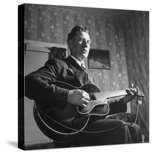 Considered Father of Country Western Music, AP Carter, Singing and Playing Guitar by Eric Schaal