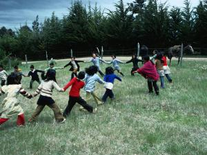 Indigenous Mapuche Children Playing on Outskirts of Town, Chol Chol, La Araucania, Chile by Eric Wheater