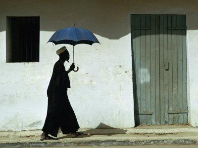 Man Walking with Umbrella, St. Louis, Senegal