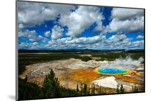 Grand Prismatic Pool at Yellowstone National Park with Blue Sky and Puffy Clouds by eric1513