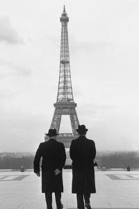 Andre-Francois Poncet walking towards the Eiffel Tower during Adenauer's first visit  Paris in 1951 by Erich Lessing