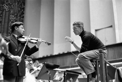 Conductor Herbert von Karajan rehearsing with Nathan Milstein in Lucerne, Switzerland. Lucerne,1957