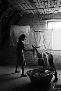 Postwar Berlin-West: hanging the washing in an attic. Berlin,1960. by Erich Lessing