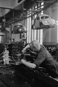 Production line of the 1951 Volkswagen model at the Volkswagen factory in Wolfsburg, West-Germany. by Erich Lessing