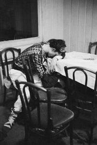 Some 800 balls take place during Vienna's carnival. A tired dancer takes a nap.1953 by Erich Lessing