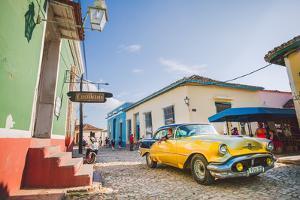 Old Car On Cobblestone Street In Trinidad, Cuba by Erik Kruthoff