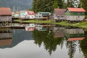 Houses of an Alaskan Fishing Village Reflect in Water by Erika Skogg
