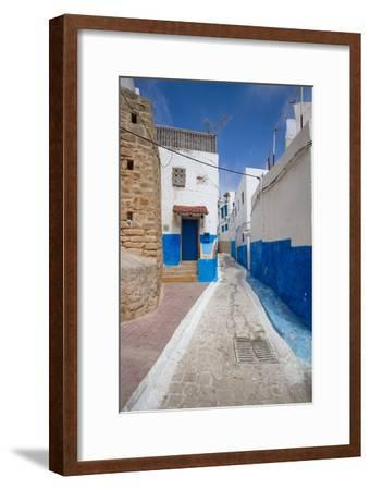 Narrow Neighborhood Streets Decorated in Blue and White