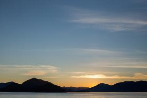 Sunset over the Mountains Within Alaska's Inside Passage by Erika Skogg