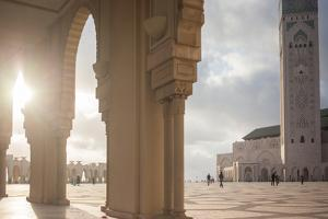 The Sun Setting Between Archways of Hassan Ii Mosque, Casablanca, Morocco by Erika Skogg