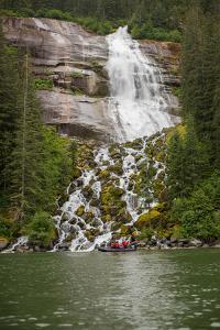 Tourists in Zodiac Boat Visit Waterfalls Within Alaska's Inside Passage by Erika Skogg