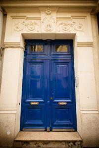 Blue Door in Paris by Erin Berzel
