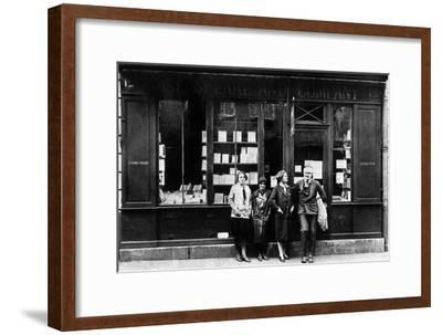 Ernest Hemingway and Sylvia Beach Infront of the 'Shakespeare and Company' Bookshop, Paris, 1928--Framed Photo