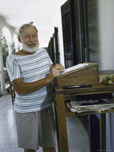 Ernest Hemingway at the Standing Desk on the Balcony of Bill Davis's Home Near Malaga-Loomis Dean-Premium Photographic Print