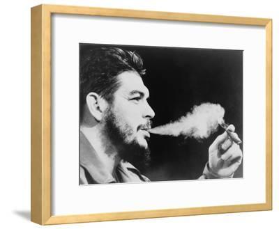 Ernesto 'Che' Guevara Exhaling Plume of Cigar, NYC, 1964
