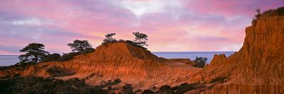 Eroded Hill with Ocean in the Background--Photographic Print