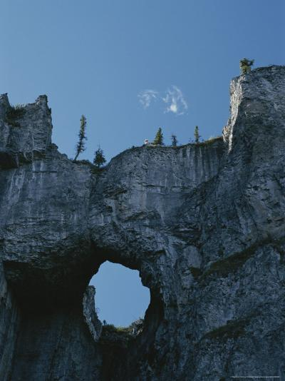 Erosion Carves a Window Into Limestone Rock in Nahanni National Park-Raymond Gehman-Photographic Print