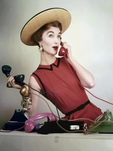 Vogue - April 1953 - Juggling Phone Calls by Erwin Blumenfeld