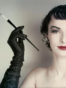Vogue - October 1952 - Woman with Cigarette Holder by Erwin Blumenfeld