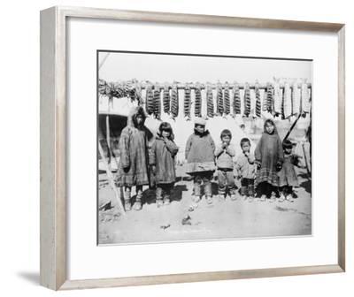 Eskimo Children in front of Dried Salmon Photograph - Alaska-Lantern Press-Framed Art Print